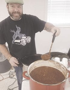 "Chad Gibson described his chili as ""a bowl of fire."""